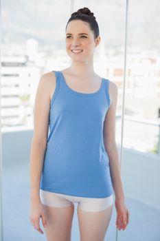 Thoughtful slender woman in sportswear posing