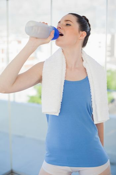Pretty slender woman hydrating