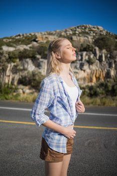 Stylish woman enjoying the sunshine