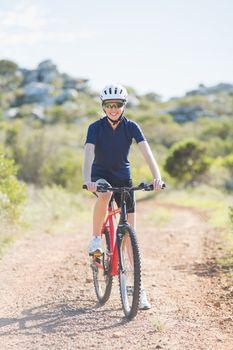 Woman mountain biking outside