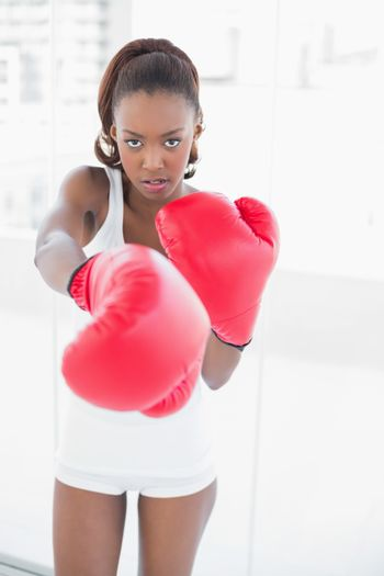 Slender athletic woman boxing