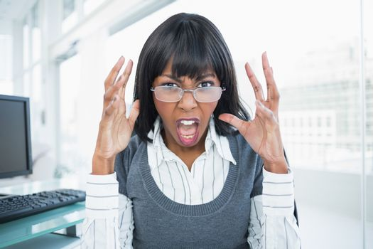 Furious businesswoman screaming