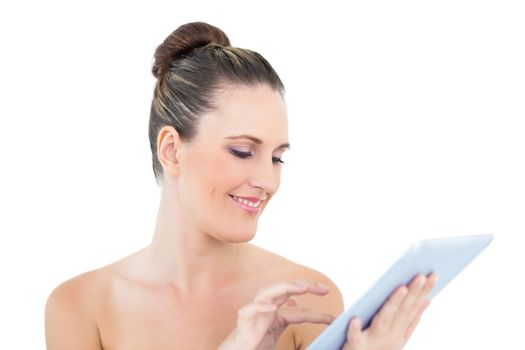 Smiling woman scrolling on her tablet