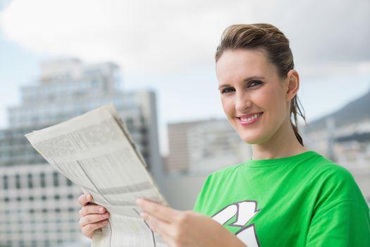 Environmental activist holding newspaper