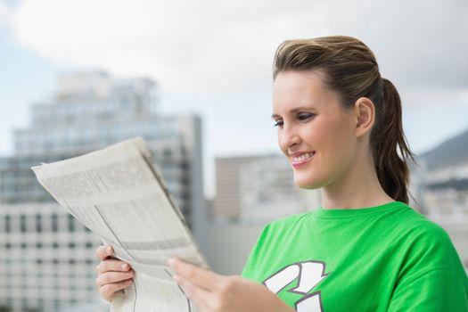 Environmental activist reading newspaper