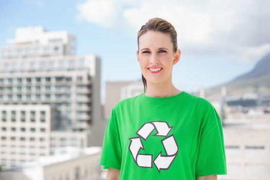 Smiling environmental activist outside