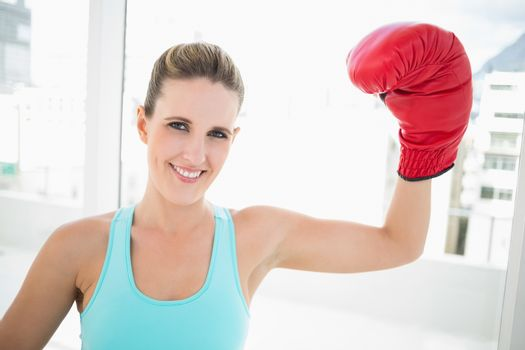 Woman rising her boxing glove up