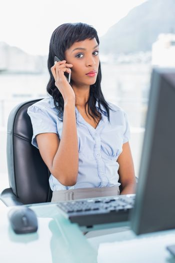 Unsmiling businesswoman having a phone call