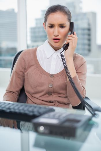 Furious businesswoman picking up the phone