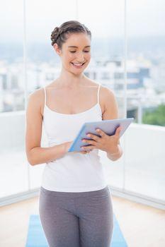 Happy sporty model scrolling on tablet pc