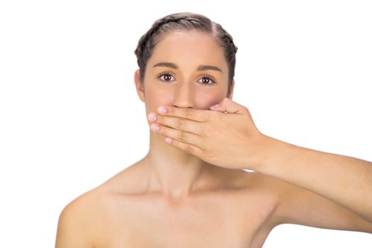 Unsmiling woman hiding her mouth