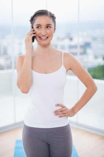 Content sporty brunette on the phone