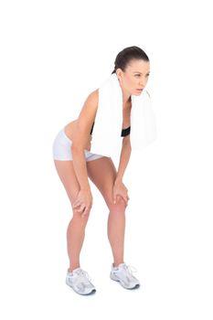 Competitive fit model in sportswear holding sport towel