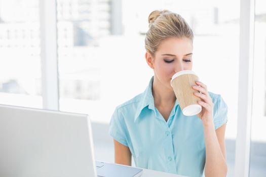 Well dressed businesswoman drinking coffee