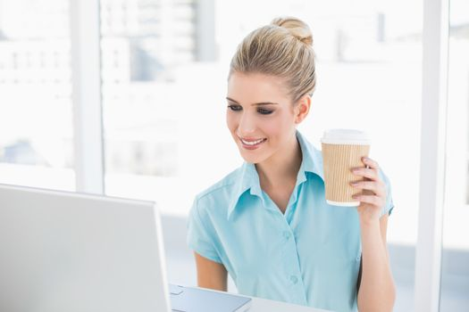 Well dressed businesswoman holding coffee
