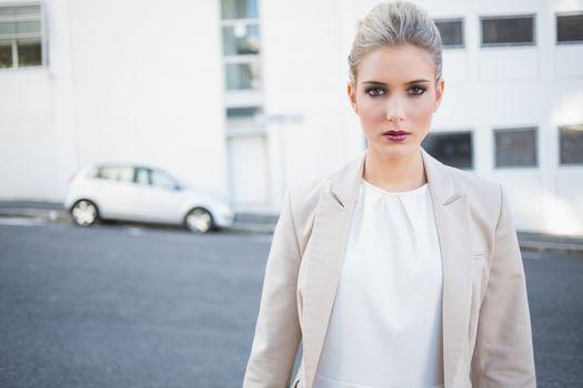 Stern stylish businesswoman posing