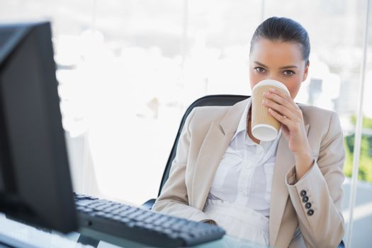 Peaceful sophisticated businesswoman drinking coffee