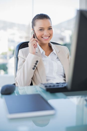 Smiling sophisticated businesswoman on the phone
