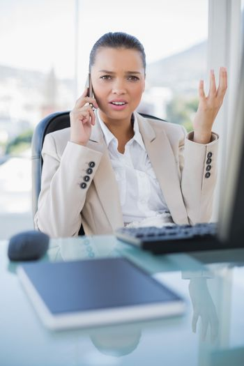 Offended sophisticated businesswoman on the phone