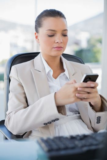 Peaceful sophisticated businesswoman texting