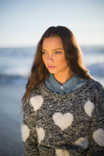 Pensive gorgeous woman with pullover posing