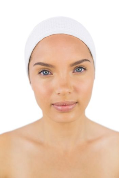 Beuatiful woman wearing a headband looking at camera