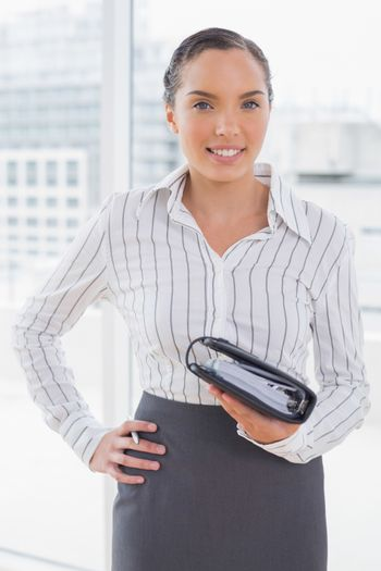Pretty businesswoman holding her appointment calendar