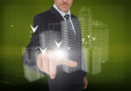 Businessman pointing at holographic faint city