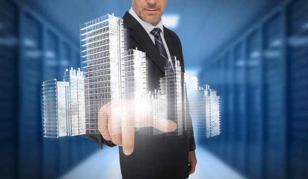 Businessman touching holographic city
