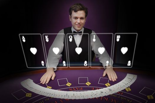 Picture of croupier standing behind holographic cards