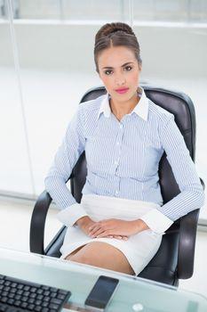 Content businesswoman sitting at desk