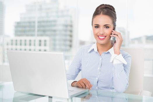 Cheerful businesswoman phoning