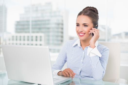 Smiling businesswoman phoning