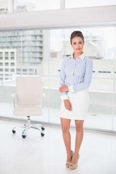 Content brunette businesswoman standing