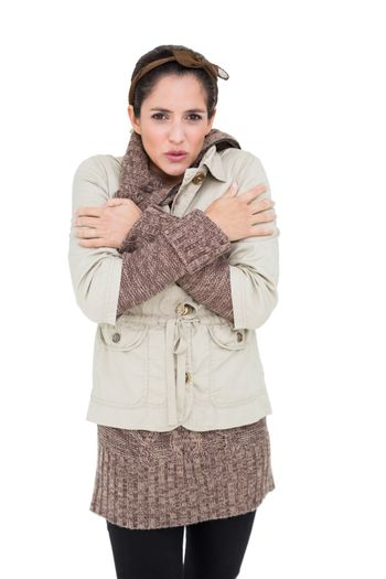 Freezing cute brunette in winter fashion looking at camera