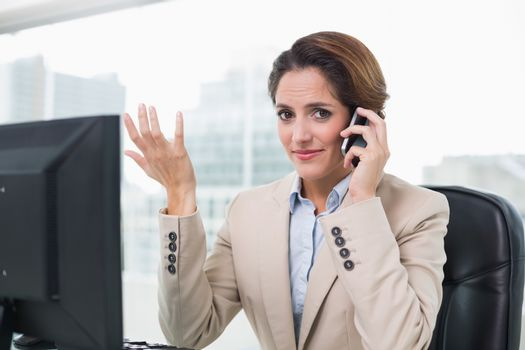 Gesturing businesswoman phoning