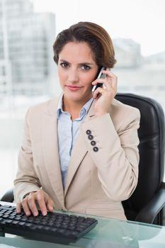 Stern businesswoman phoning