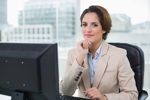 Content businesswoman looking at camera