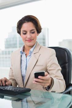 Content businesswoman holding smartphone
