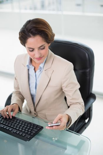 Content businesswoman looking at smartphone