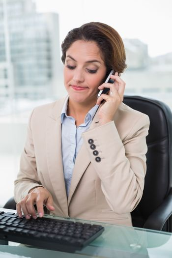 Frowning businesswoman phoning