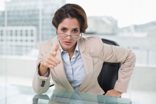 Irritated businesswoman looking at camera