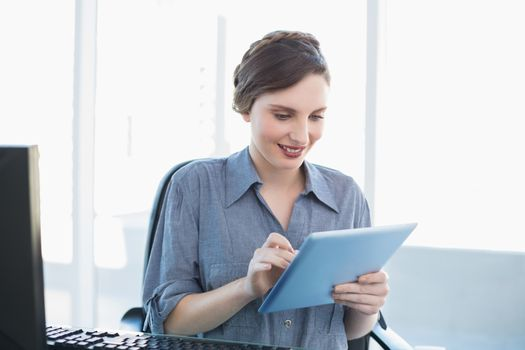 Content businesswoman working with her tablet