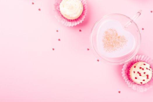 Heart shape love drink cup , latte coffee milk love potion milkshake concept and cupcakes on pink background with copy space for text