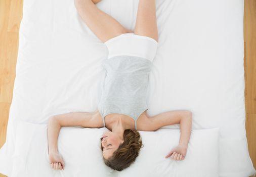 Beautiful slender woman sleeping lying on her bed