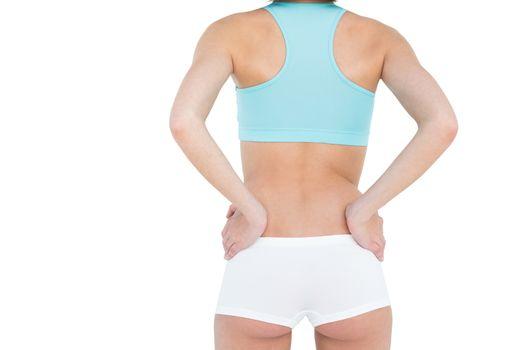 Rear view of slender woman wearing sportswear