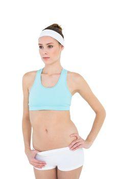 Thoughtful slender woman posing wearing sportswear