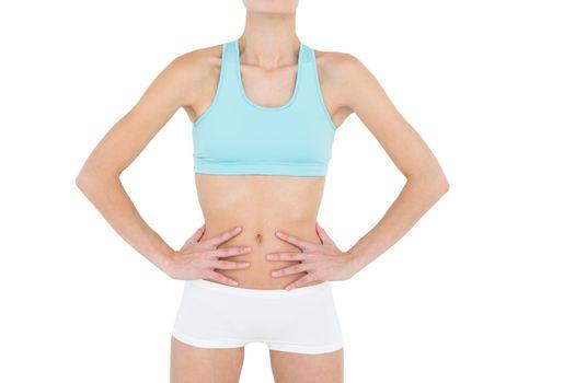 Mid section of slender woman wearing sportswear