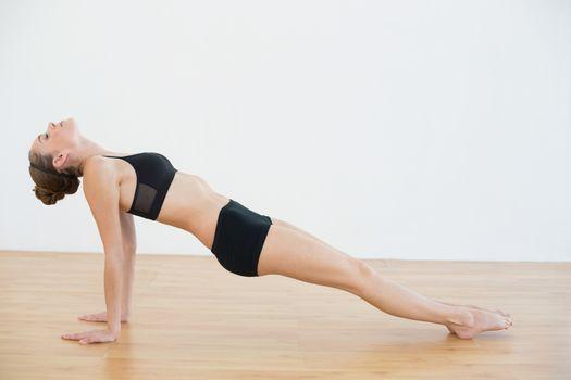 Slender woman doing yoga pose