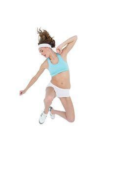 Sporty slender woman wearing sportswear jumping